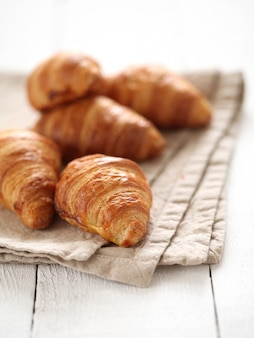 Fresh french croissants on a tablecloth