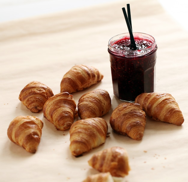 Fresh french croissants with berry jam