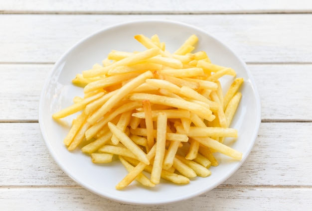 Fresh french fries on white plate delicious italian meny homemade ingredients - tasty potato fries for food or snack