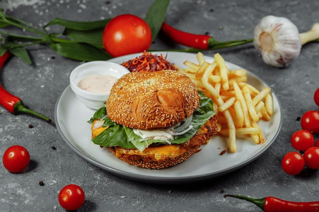 Fresh and fried fish burger with vegetables.