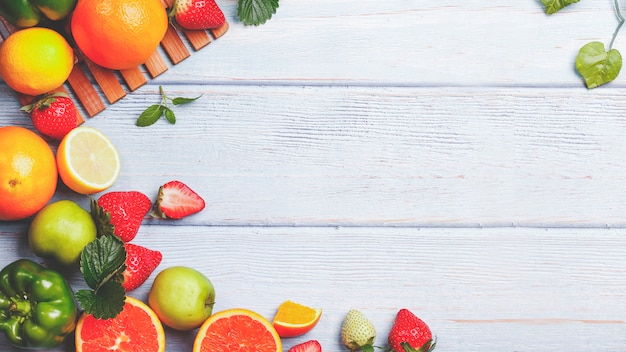 Fresh fruit background in summer. on a white wooden table.