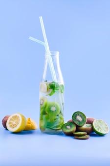 Fresh fruit cocktail in bottle