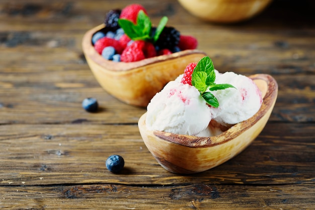 Fresh fruit ice cream with mint on the wooden table