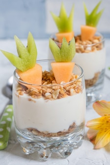 Fresh fruit parfait with yogurt and granola for easter breakfast