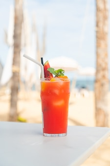 Fresh fruit punch with sea beach background