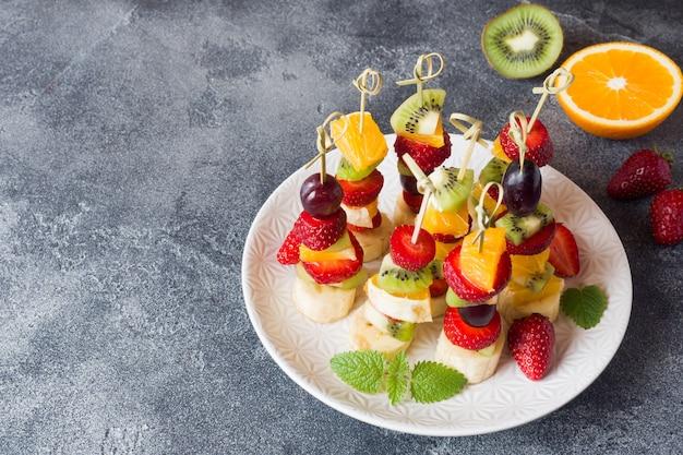 Fresh fruit on skewers.