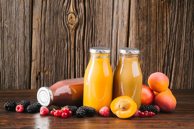 Fresh fruit smoothies on wooden background