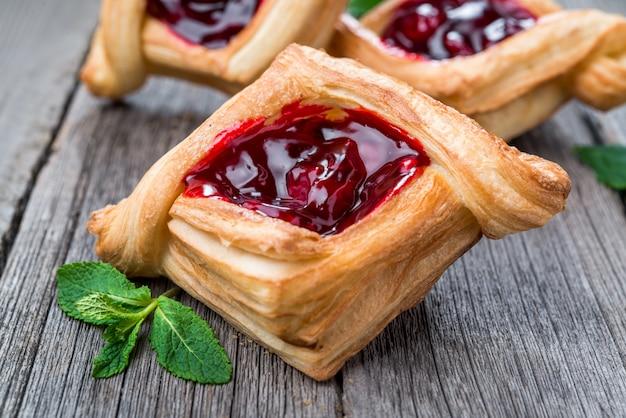 Fresh fruit tart with berries jam , mint on wooden table. desert.