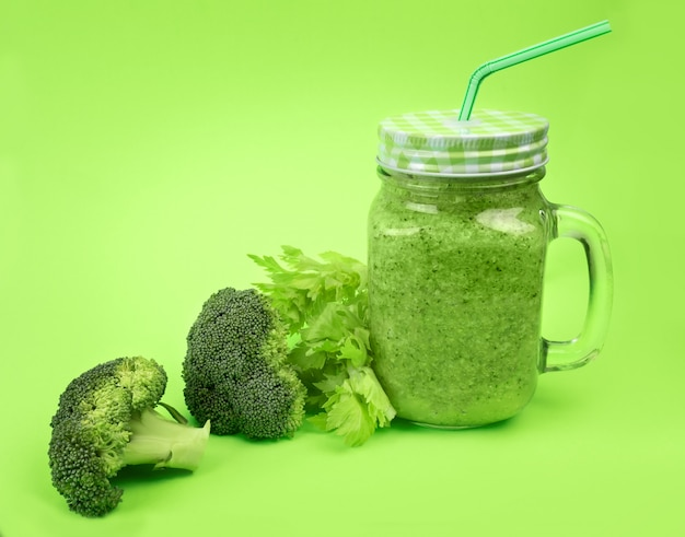 Fresh fruit vegetable broccoli celery smoothie shake lime green.