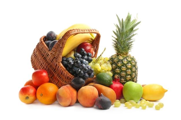 Fresh fruits and basket on white