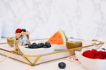 Fresh fruits; oats and blueberries on tray