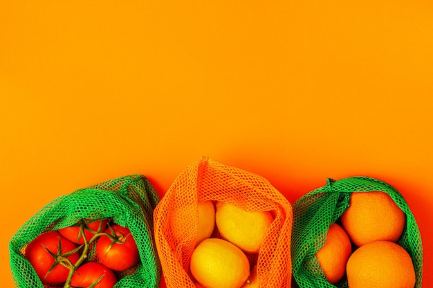 Fresh fruits and vegetables in reusable textile mesh bags