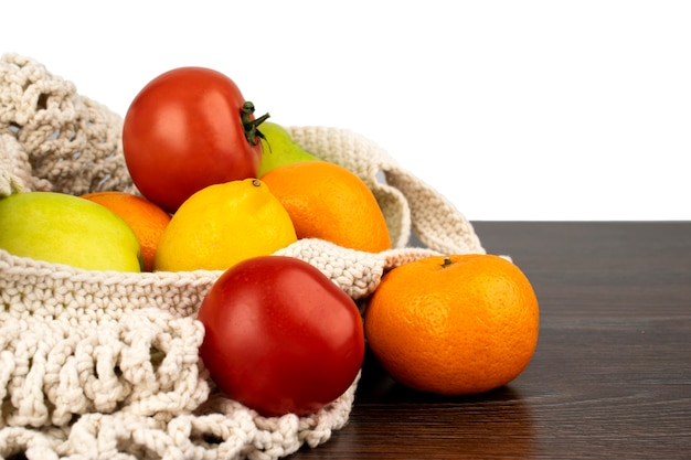 Fresh fruits and vegetables in a string bag, food