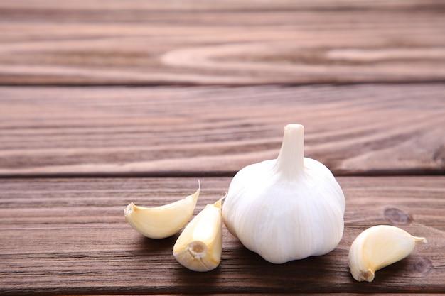 Fresh garlic on a brown wooden background