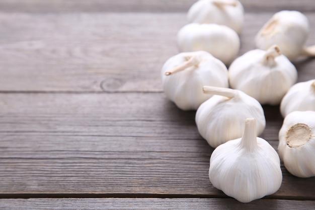 Fresh garlic on a grey wooden background