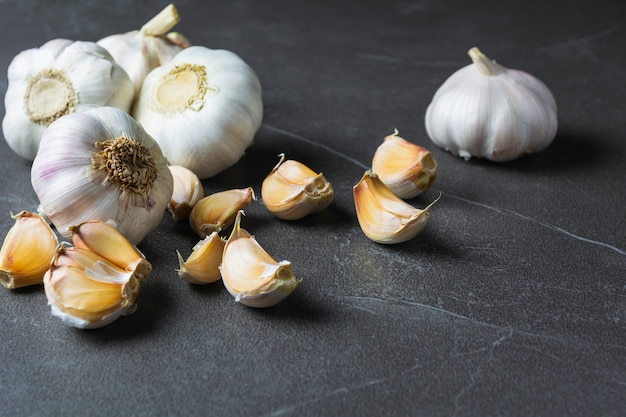 Fresh garlic sliced and garlic bulb