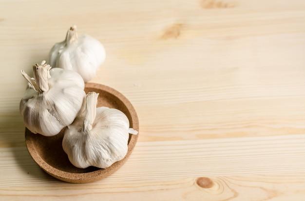 Fresh garlic on white wooden table