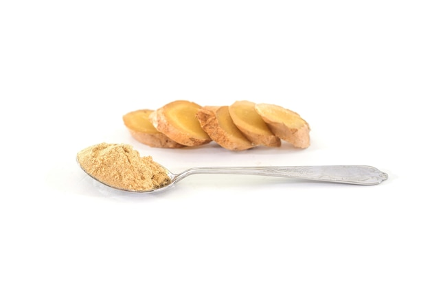 Fresh ginger root and ginger powder in spoon isolated, healthy spices