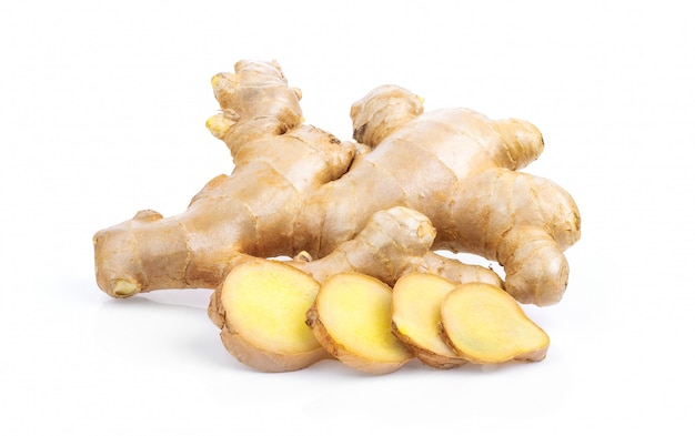 Fresh ginger root and slice isolated .