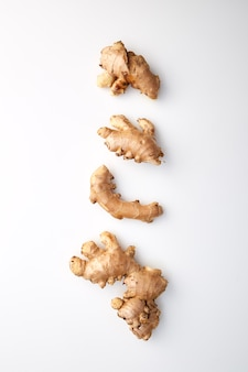 Fresh ginger on white background