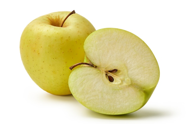 The fresh golden delicious apples are isolated on a white background. a whole apple and half.