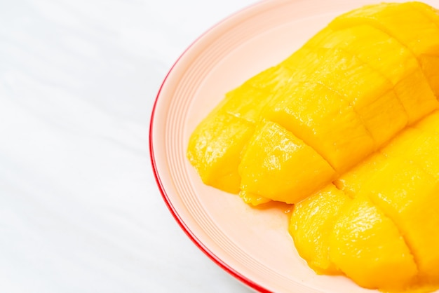 Fresh and golden mango sliced on plate