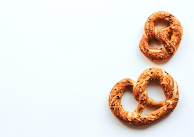 Fresh golden pretzels on white
