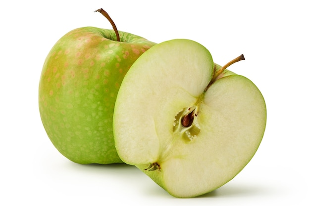 The fresh granny smith apples are isolated on a white background. a whole apple and half.