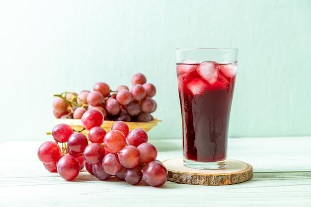 Fresh grape juice on wooden table
