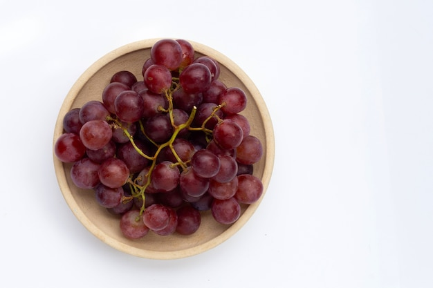 Fresh grape in plate on white background.