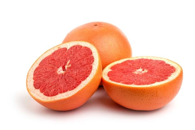 Fresh grapefruit isolated on white surface .