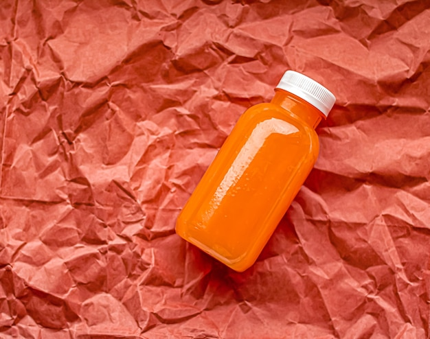 Fresh grapefruit juice in ecofriendly recyclable plastic bottle and packaging healthy drink and food...