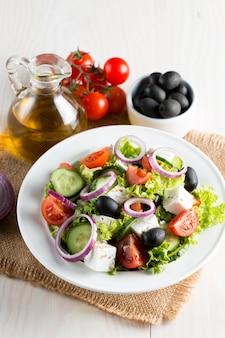Fresh greek salad made of cherry tomato, ruccola, arugula, feta, olives, cucumbers, onion and spices.