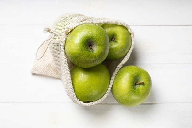 Fresh green apples in an eco-friendly fruit bag