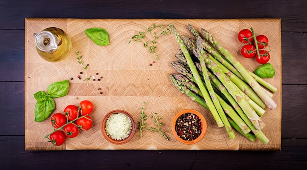 Fresh green asparagus on a rustic wooden table with. top view