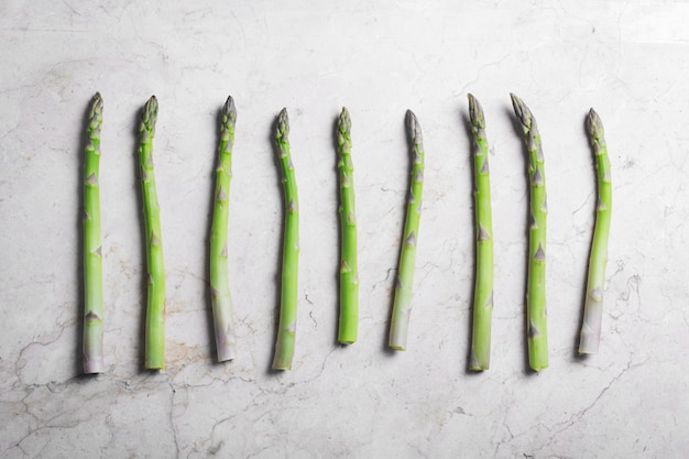 Fresh green asparagus on stone marble surface