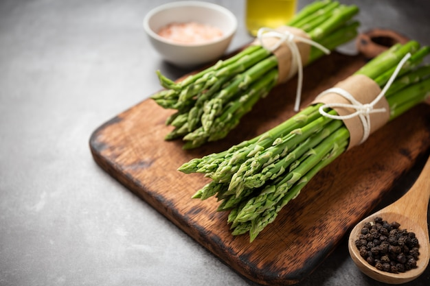Fresh green asparagus on table.