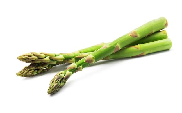 Fresh green asparagus on a white background