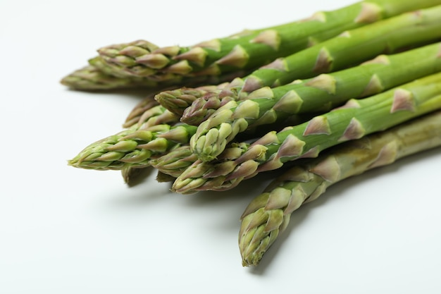 Fresh green asparagus on white, close up