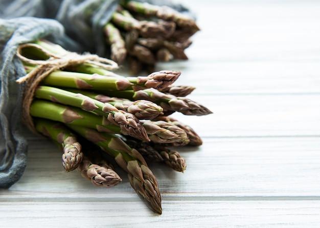 Fresh green asparagus on a white surface