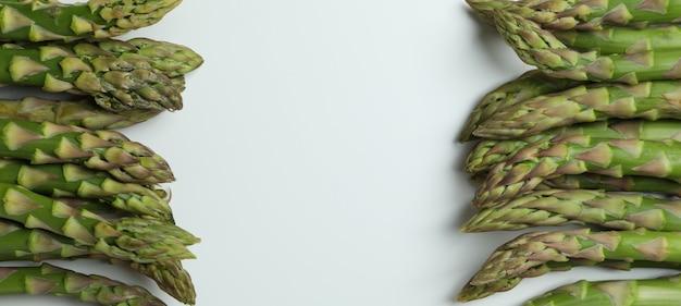 Fresh green asparagus on white