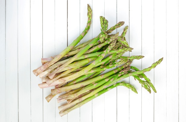 Fresh green asparagus on white.