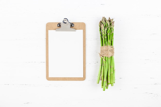 Fresh green asparagus with paper clipboard background