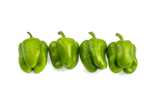 Fresh green bell pepper or capsicum on a white