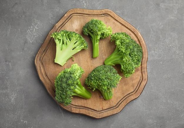 Fresh green broccoli on grey table, top view