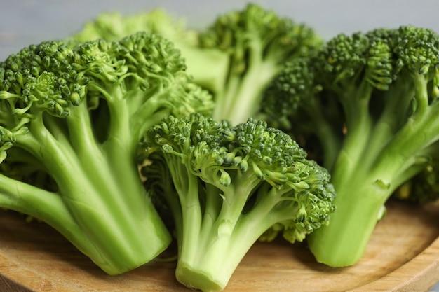 Fresh green broccoli on wooden board, closeup