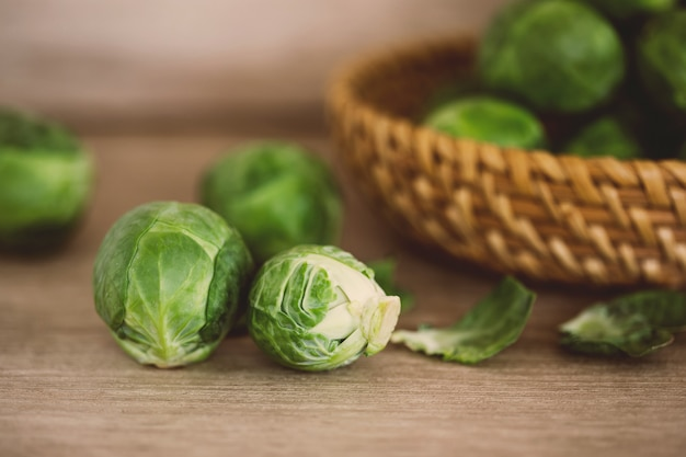 Fresh green brussel sprouts vegetable on a wooden brown table , healthy fresh vegetable concept