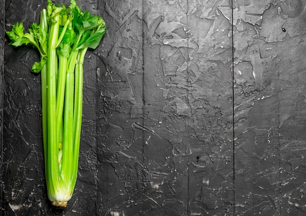 Fresh green celery. on rustic background
