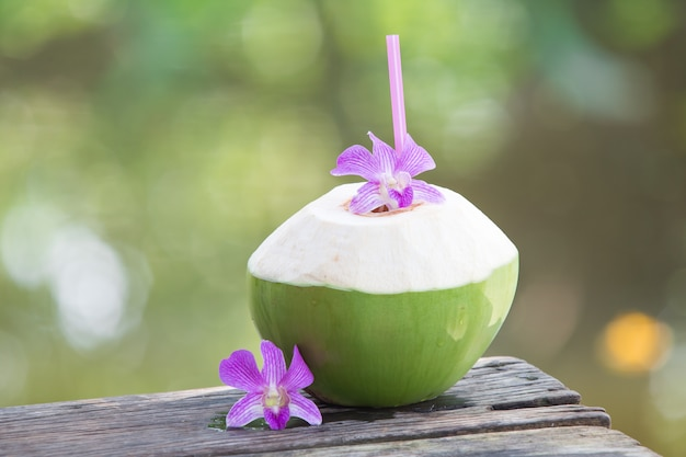 Fresh green coconuts with drinking straw