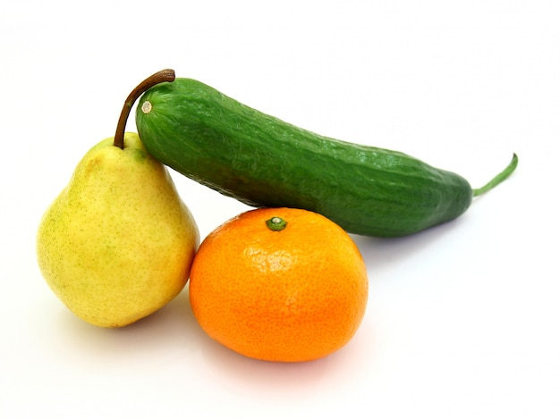 Fresh green cucumber with a tangerine and a pear lie on a white space